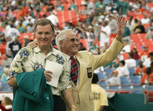 Former Miami Dolphins Bob Griese, left, and coach Don Shula wave to the crowd in this Dec. 16, 2007 file photo, in Miami, as the two celebrated the 35th anniversary of the 1972 undefeated football team. (AP Photo/J. Pat Carter)